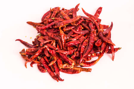 Dried red chili or chilli cayenne pepper isolated on white background