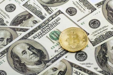 Bitcoin over the dollars background Stok Fotoğraf