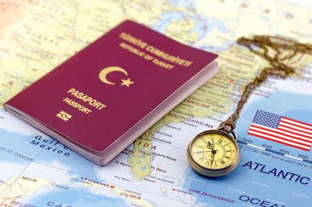 Turkish passport and pocket watch on US Map