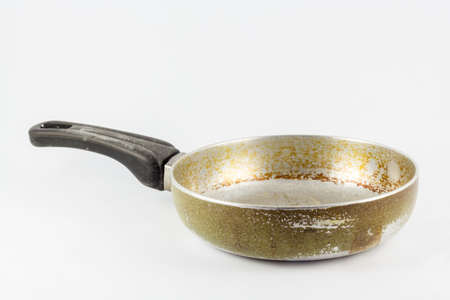 Old round skillet isolated on white background,