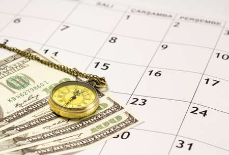 Pocket watch with money on the calendar. Time is money. Banco de Imagens