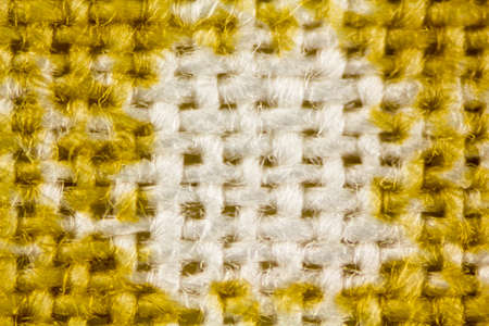 close up of yellow and white mesh fabric