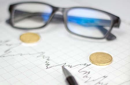 glasses pen coin graphic