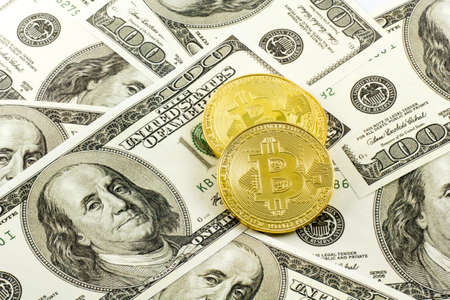 bitcoin over US dollar bills Stok Fotoğraf