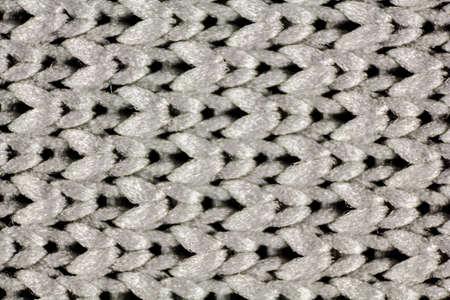 primo piano di tessuto a rete grigio