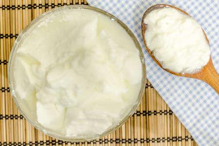 Natural homemade plain organic yogurt with wood spoon Stock Photo