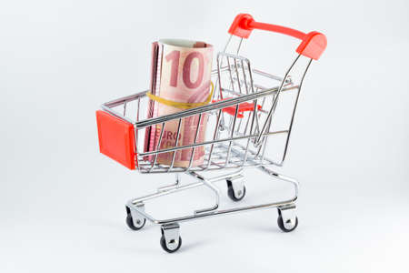 rolled euro on market cart Stok Fotoğraf
