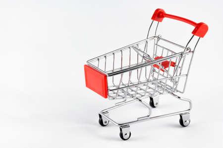 Mini shopping trolley, isolated on white background Stok Fotoğraf