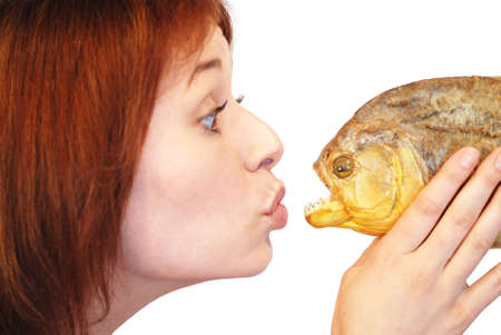 rapprochement: Girl kissing piranha Stock Photo