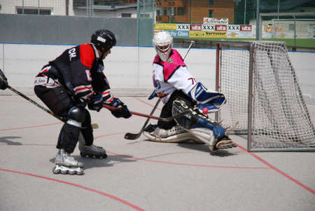 bodycheck: IHC Roadrunners Zell am See vs. Heartbreakers Zell am See. Western conference finals of the austrian Inline-Hockey League on August 4, 2007 in Zell Am See, Austria