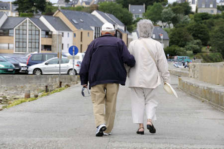 Senior couple walking together holding their hands. Stock Photo