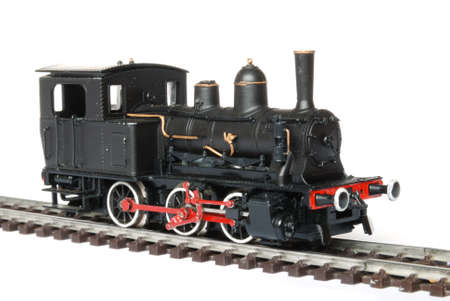 Vintage black model railway isolated on white background photo