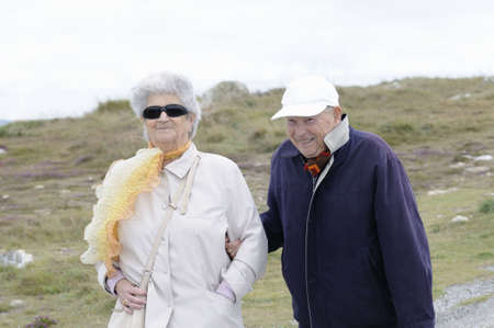 Happy senior couple holding hands and smiling Stock Photo - 7816837