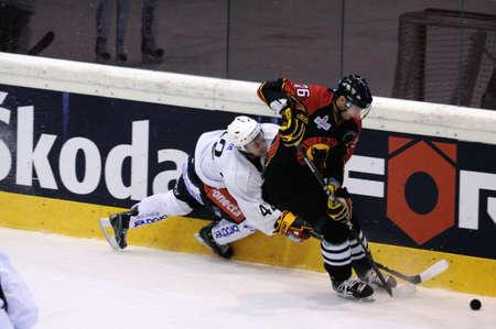 ZELL AM SEE, AUSTRIA - SEPTEMBER 3: Red Bulls Salute Tournament. Ben Eaves (Jokerit) crashes into the boards. Game Jokerit Helsinki vs. SC Bern (Result 0-2) on September 3, 2010 in Zell am See