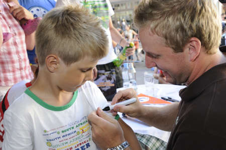 sabre's: Zell am See, Austria - Jul 8. NHL star hockey player Thomas Vanek visits his hometown Zell am See in Austria on 8th July 2010, to speak to young players of Zell am See and giving autographs.
