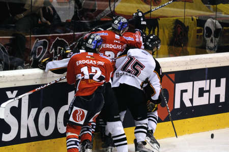 bodycheck: ZELL AM SEE; AUSTRIA - SEPTEMBER 4: Red Bull Salute Tournament Semifinal. Scrum at the boards.  Game between SC Bern and Eisbaeren Berlin (Result 1-5) on September 4, 2010.