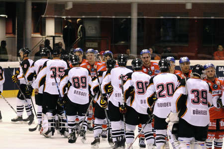 bodycheck: ZELL AM SEE; AUSTRIA - SEPTEMBER 4: Red Bull Salute Tournament Semifinal. Shake hands after the game. Game between SC Bern and Eisbaeren Berlin (Result 1-5) on September 4, 2010.