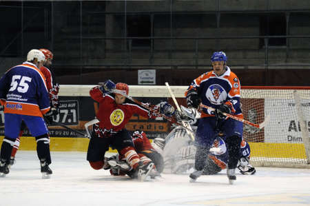 oldies: ZELL AM SEE, AUSTRIA - SEPTEMBER 30: Austrian Icehockey Classic Tournament. Action in front of Pallojussits keeper. Game Zell am See Oldies vs. Pallojussit (Result 3-3) on September 30, 2010 in Zell am See