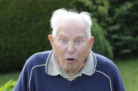 Shot of crazy senior man with funny grimace Stock Photo