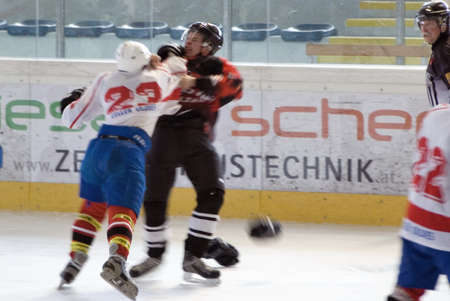 misconduct: ZELL AM SEE, AUSTRIA - 27 MARCH. Benedikt Hahn fighting Kontschieder at the game between Salzburg Devils and SV Schuettdorf (3-12) on March 27 2010 in Zell am See.