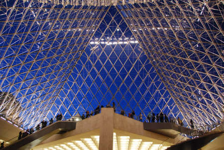 louvre pyramid: PARIS - JAN 10: Inside the Louvre pyramid on Jan 10, 2008 in Paris. Visitors leaving museum as it closes. Editorial