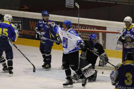 grazer: ZELL AM SEE, AUSTRIA - OCT 1: Austrian Icehockey Classic Tournament. Zdenek Vanek - father of NHL star Thomas Vanek - scores. Game Grazer Oldies vs. West coast stars (Result 2-2).