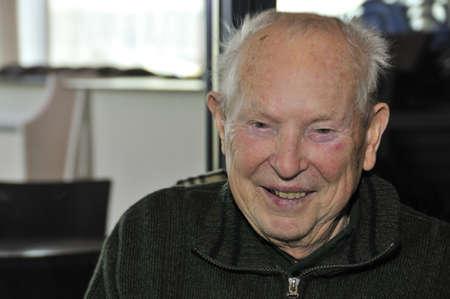 Shot of happy 90 years old senior smiling.