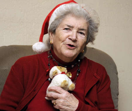 Funny old senior woman at christmas party Stock Photo