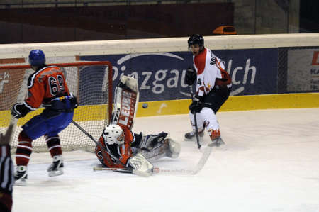 bodycheck: Great save by Schuettdorf Goalie Peter Hochwimmer. Game between SV Schuettdorf and Devils Salzburg  (Result 2-13) on November 28, 2010, at the hockey rink of Zell am See