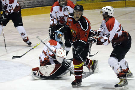 bodycheck: Unterberger gets crosschecked by Devils player. Game between SV Schuettdorf and Devils Salzburg  (Result 2-13) on November 28, 2010, at the hockey rink of Zell am See