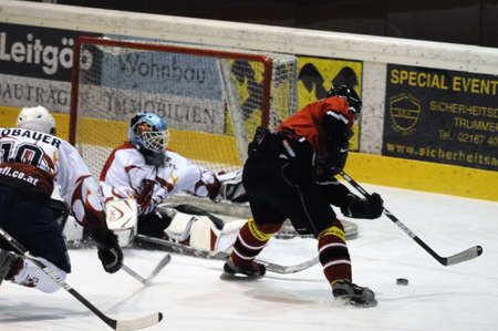 bodycheck: Scoring chance for Schuettdorf in the second period. Game between SV Schuettdorf and Devils Salzburg  (Result 2-13) on November 28, 2010, at the hockey rink of Zell am See