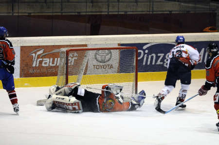 bodycheck: Schoen scores for Salzburg in the third period. Game between SV Schuettdorf and Devils Salzburg  (Result 2-13) on November 28, 2010, at the hockey rink of Zell am See