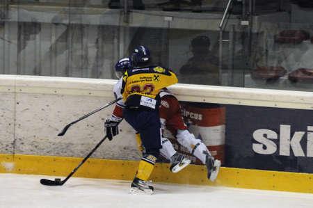 bodycheck: ZELL AM SEE, AUSTRIA - NOVEMBER 30: Austrian National League. Graz player gets hit. Game EK Zell am See vs. ATSE Graz (Result 0-4) on November 30, 2010, at hockey rink of Zell am See