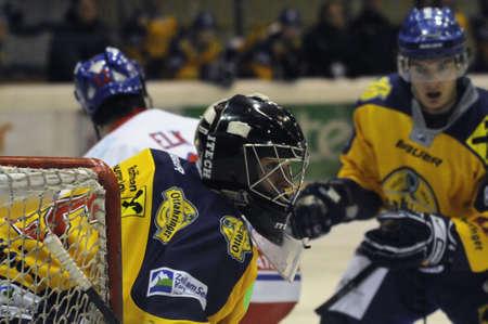bodycheck: ZELL AM SEE, AUSTRIA - NOVEMBER 30: Austrian National League. Zell am See goalie Bartholomaeus. Game EK Zell am See vs. ATSE Graz (Result 0-4) on November 30, 2010, at hockey rink of Zell am See Editorial
