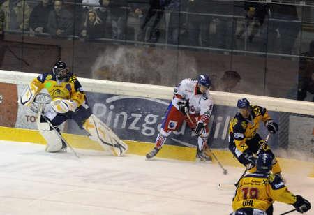 bodycheck: ZELL AM SEE, AUSTRIA - NOVEMBER 30: Austrian National League. Goalie Bartholomaeus leaving his crease. Game EK Zell am See vs. ATSE Graz (Result 0-4) on November 30, 2010, at hockey rink of Zell am See