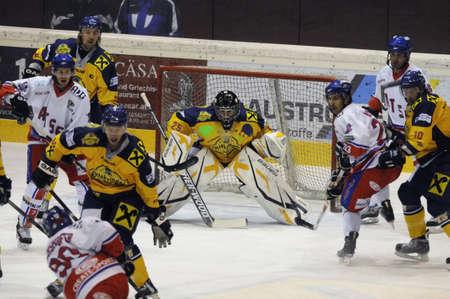 bodycheck: ZELL AM SEE, AUSTRIA - NOVEMBER 30: Austrian National League. Scoring chance for ATSE Graz. Game EK Zell am See vs. ATSE Graz (Result 0-4) on November 30, 2010, at hockey rink of Zell am See Editorial