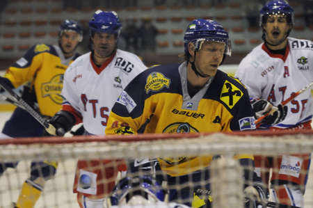 ZELL AM SEE, AUSTRIA - NOVEMBER 30: Austrian National League. Jari Suorsa in front of Keeper Seidl. Game EK Zell am See vs. ATSE Graz (Result 0-4) on November 30, 2010, at hockey rink of Zell am See