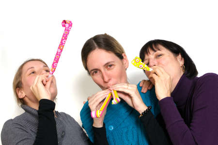 Two young women and her mother celebrating New year's eve. Shot taken in front of white background Stock Photo - 8378721