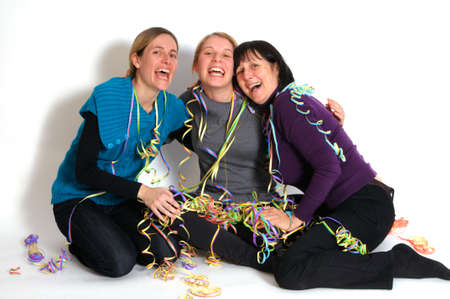 Two young women and her mother celebrating New year's eve. Shot taken in front of white background Stock Photo - 8378720