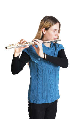 Young woman playing transverse flute isolated on white background. Stock Photo