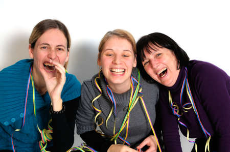 Two young women and one senior woman laughing at party. Stock Photo - 8378763