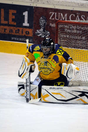 ZELL AM SEE, AUSTRIA - DECEMBER 7: Austrian National League. Save by Goalie Bartholomaeus. Game EK Zell am See vs. Red Bulls Salzburg (Result 4-6) on December 7, 2010, at hockey rink of Zell am See