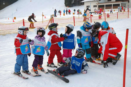 ZELL AM SEE, AUSTRIA - DECEMBER 22: 3-5 year old children at Ski school in Zell am See, Austria. Austrian ski schools are famous for the training plans, that guarantees the safety of about 10 million ski drivers on austrian ski areas per year.
