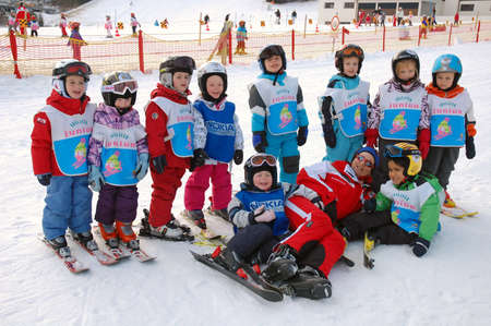 am: ZELL AM SEE, AUSTRIA - DECEMBER 22: 3-5 year old children at Ski school in Zell am See, Austria. Austrian ski schools are famous for the training plans, that guarantees the safety of about 10 million ski drivers on austrian ski areas per year.