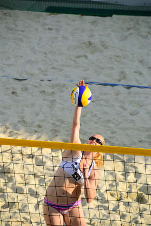 center court: ZELL AM SEE, AUSTRIA - JUNE 26: Participant at the Beach City 2010 Center court, the biggest amateur Beach Volleyball Tournament in Austria. June 26, 2010 in Zell am See, Austria