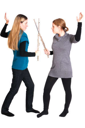 rivalry: Rivalry between two young women with transverse flute isolated on white background.