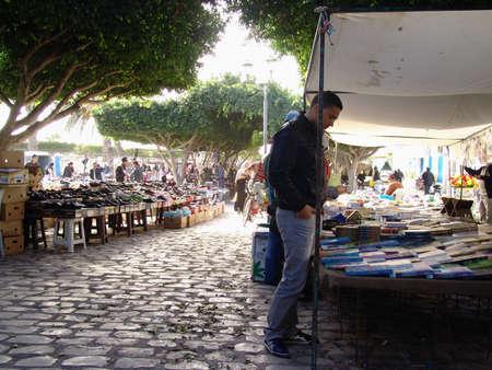 MADHIA, TUNISIA - DECEMBER 12: People at typical traditional tunisian street market in Madhia. December 12, 2010 in Madhia, Tunisia.