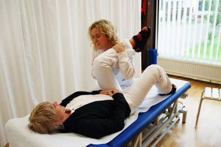 strength therapy: SAALFELDEN, AUSTRIA - AUGUST 30: physical therapist exercising with female rheumatism patient on August 30, 2007 at rehabilitation center in Saalfelden, Austria.