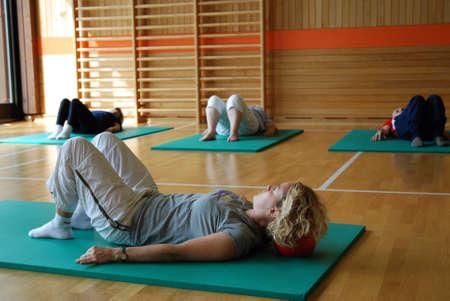 SAALFELDEN, AUSTRIA - AUGUST 30: physical therapist exercising with rheumatism patient group on August 30, 2007 at rehabilitation center in Saalfelden, Austria. Stock Photo - 8526291