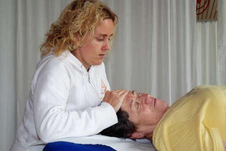 saalfelden: SAALFELDEN, AUSTRIA - AUGUST 30: physical therapist exercising with senior rheumatism patient on August 30, 2007 at rehabilitation center in Saalfelden, Austria. Editorial